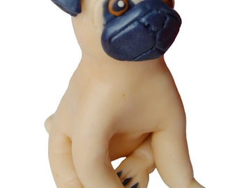 Dog fondant cake topper. Edible figurine of a pug. Fondant pet for a cake.