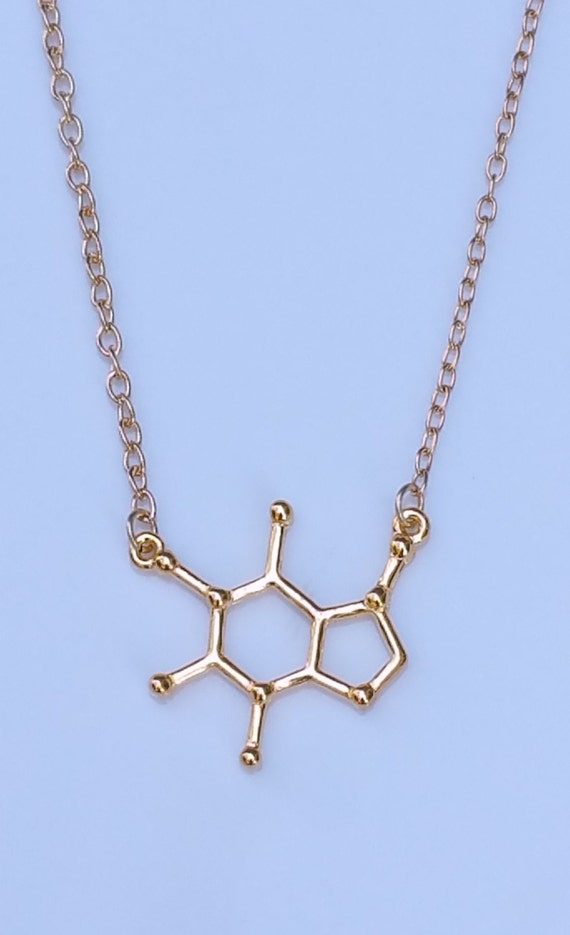 gold caffeine molecule necklace by newodesigns on etsy