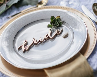bride and groom gold laser cut calligraphy place cards escort cards name tags