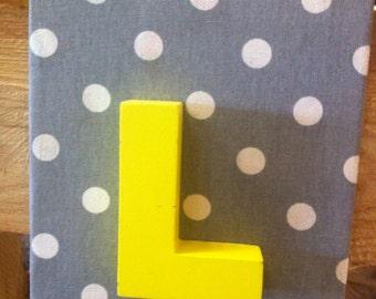 "3D yellow ""L"" canvas"