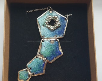 Pentagons Enamel Pendant. Copper pentagons with beautiful sea colors enamel and melted around stirling silver