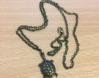 Sweet vintage turtle necklace and a vintage butterfly necklace
