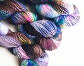 creature / hand dyed yarn / speckle yarn / superwash merino wool sock yarn / single fingering sock yarn / blue brown multi speckle yarn