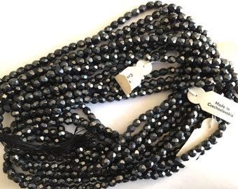 Vintage Czech bead strand tagged faceted hematite shiny glass gray black crystal glass  8 x 6mm  (approx 120 beads)