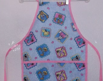 Child's Apron with Toy Pictures  #1012  Size Medium