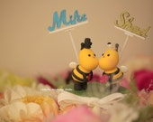 Kissing Bees bride and groom wedding cake topper