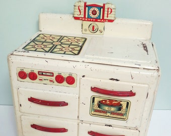 Marx Pretty Maid Toy Stove, Art Deco Salt & Pepper Shakers, Working Knobs, Clock Hands, 2 Oven Doors that Open, Red Metal Handles