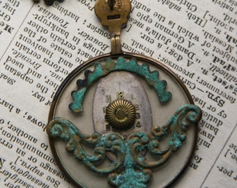 Vintage OPTICAL LENS NECKLACE- with Verdigris Embellishments- Watch Face- Found Object Jewelry