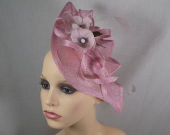 A pink hatinator/fascinator