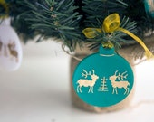 Hand painted golden reindeers over green acrylic christmas tree ball ornament