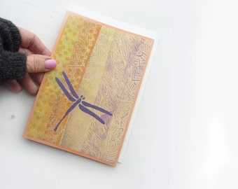 Painted Greeting Card-  Purple Dragonfly on orange and yellow background