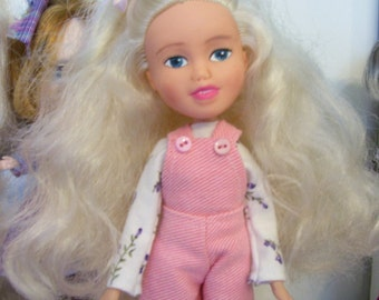Hi Meet Emma..bratz make under doll/repaint...Includes Doll,  Pink Overalls, T-Shirt and Shoes