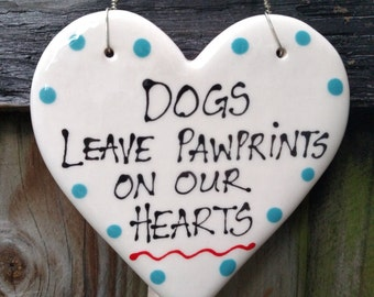 Dogs leave pawprints on our hearts hanging sign