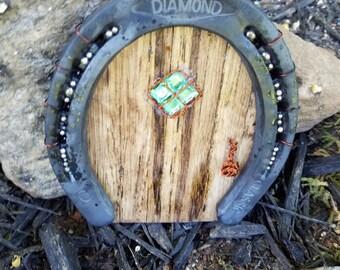 Handmade wooden fairy door with horseshoe, window and brass doorknob
