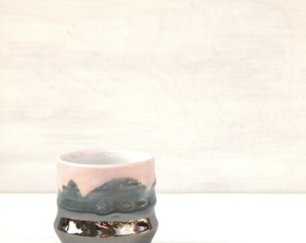 Contemporary cup in pink and metallic silver.