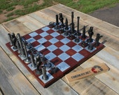pilot's chess set made from aircraft engine parts