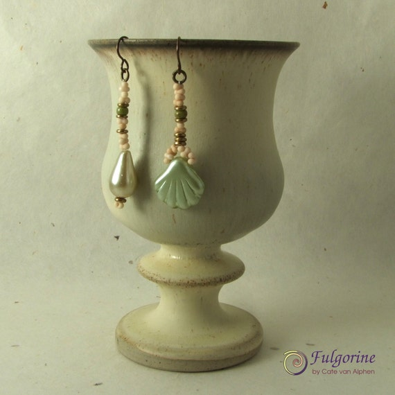 Mismatched neutral green and cream pearl bead earrings on hypo-allergenic bronze niobium ear wires