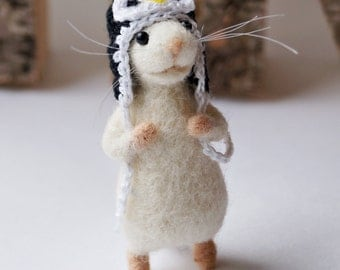 Mouse wearing penguin hat