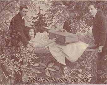 Laid Up With The Grip- 1910s Antique Postcard- Flu Epidemic- Sick Woman Carried in Litter- Morbid Humor- Art Comic- Paper Ephemera- Used