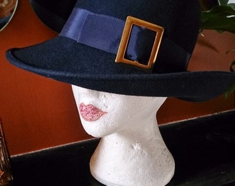 Dark navy blue fedora-style ladies vintage 1960s hat with goldtone buckle detail