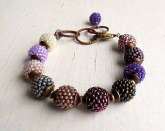 Faded Glamour - handmade bohemian-style artisan bead bracelet in vintage purple, grey and opal shades - Songbead UK, narrative jewellery