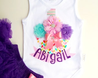 First Birthday Cupcake Onesie with Personalized Name. Party hat, Legwarmers and Skirt also available (Sold Separately)