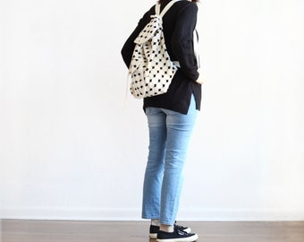 black ivory woven slouchy backpack