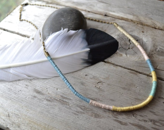 hand woven cotton and dotted brass necklace