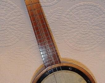 Antique Banjo Ukulele With Closed Back