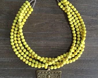 SALE! Tibetan Maya necklace - yellow howlite beads with brass Tibetan pendant