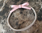 Tiny light pink bow headband - baby headband, nylon headband, newborn headband
