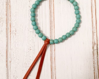 Turquoise Magnesite beaded bracelet with brown leather tassel