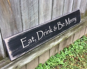 "Wooden, Handmade, Long Sign. ""Eat, Drink & Be Merry"". Wonderful home decor and a great sentiment. Antiqued, Primitive, Country wall hanging."