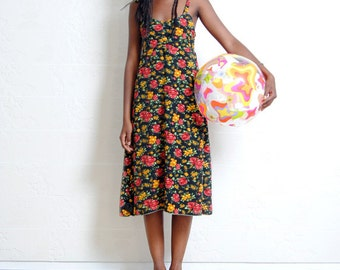 Silk dress with curling on the back. On sale from 79 euro to 39,50