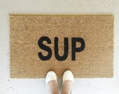 Sup - Hand-painted Coir Doormat by AfterInfinity