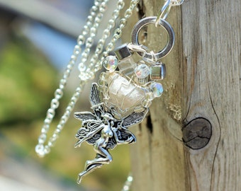 Fairy MUSKOKA STONE wire wrapped pendant is made with stirling silver wire, glass, resin and or crystal beads.