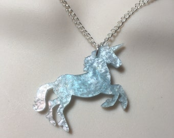 pale blue pearlised ..UNICORN pendant...on a silver plated chain