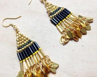 dangling earrings in gold Indian style