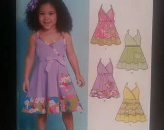 New Look 6140 Toddlers Summer Dress / Sundress 4 Styles sewing pattern sizes 1/2-1-2-3-4
