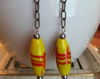 red and yellow dangle earrings