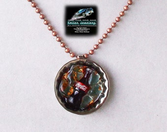 "Coke ""bottlecap"" necklace made with ""It's a Mad, Mad, Mad, Mad World"" car glass."