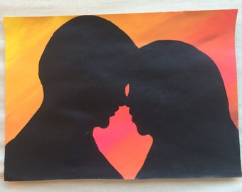 Couples Silhouette on paper (red/orange background)