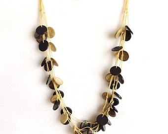 Natural coloured brown cream coconut shell necklace, round coco discs. Triple Three Loop Style With Closure.