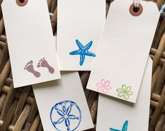 assorted coastal/tropical hand-stamped gift tags