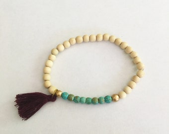 Tassel Bracelet, Tan Wooden Beads with Turquoise and Gold Accents, Marroon Tassel, Stackable Arm Candy, Stretchy Friendship Bracelet