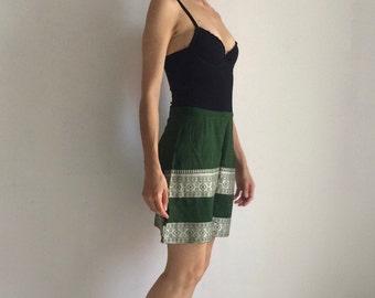 Silk green mini-skirt | embroidery