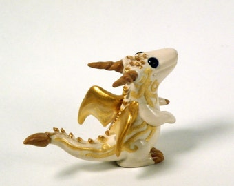 Ivory and Gold Scroll Dragon Figurine