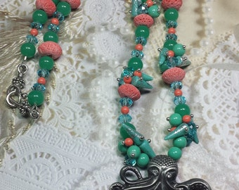 Octopus on the Beach!  Handmade beaded turquoise and coral necklace