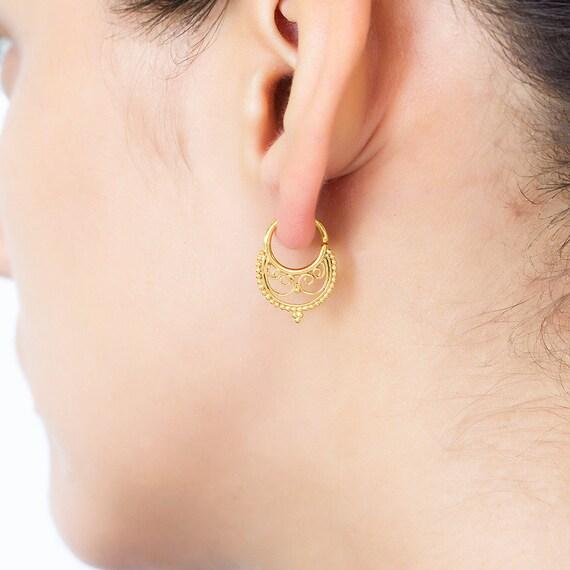 Tribal earring (single). cartilage hoop earring. forward helix earring. tragus earring. cartilage earring. helix earring. tragus earring.