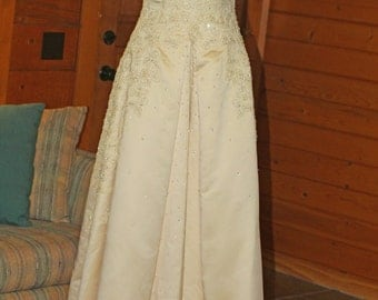 "New with tags, haute couture by Maggie Sottero pale gold wedding gown, size 8-10, ""Bianca"", sleeveless, heavily beaded Swarovski crystals."